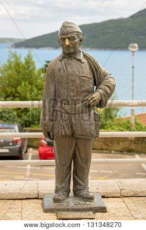 Herceg Novi, Montenegro - 14 May, 2016: Statue Of Chimney Sweep. There Is A Sign -to Be Happy You Ne