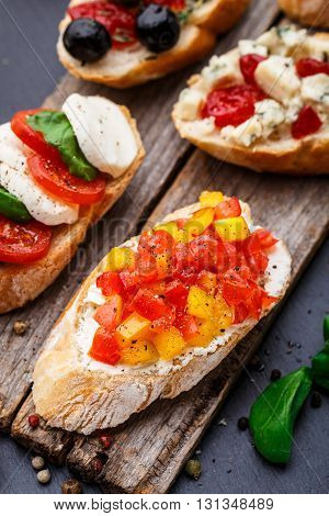 Italian bruschetta with chopped tomatoes, herbs and oil on toasted crusty ciabatta bread