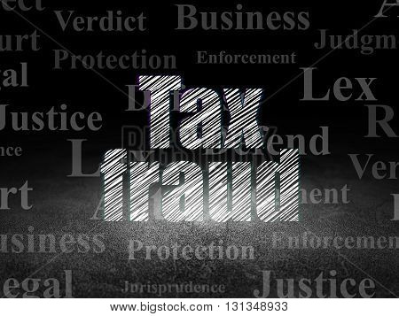 Law concept: Glowing text Tax Fraud in grunge dark room with Dirty Floor, black background with  Tag Cloud