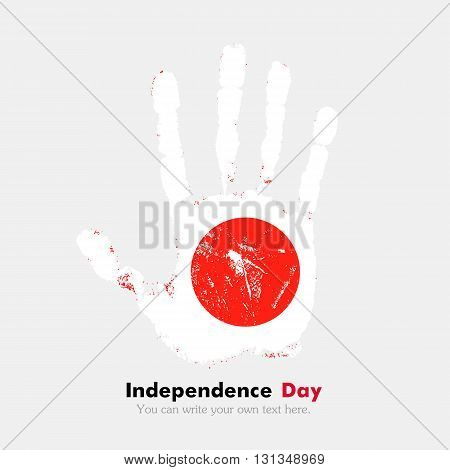 Hand print, which bears the Flag of Japan. Independence Day. Grunge style. Grungy hand print with the flag. Hand print and five fingers. Used as an icon, card, greeting, printed materials.