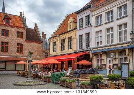 BRUGES BELGIUM - CIRCA JUNE 2014: Typical street in Bruges in June 2014. This is famous marketplace of one of the most popular touristic destination in Belgium