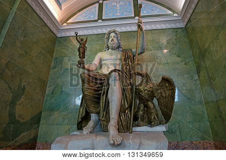 ST PETERSBURG RUSSIA - JUNE 10 2015: Statue of Jupiter in Jupiter Hall of Hermitage museum in June 10 2015 in Saint Petersburg. This is one of the biggest antique sculptures remained up to present time