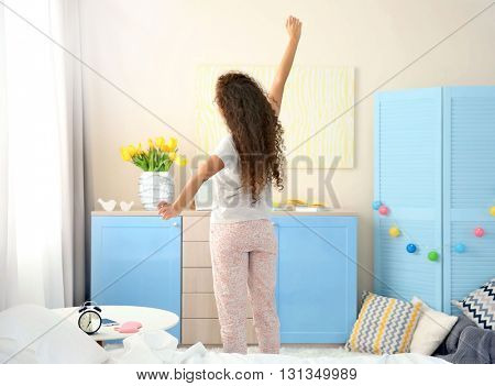 Girl stretching after wake up