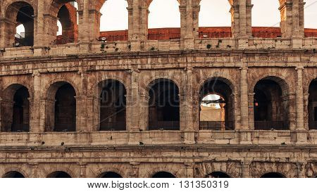 Rome, Italy: Colosseum, Flavian Amphitheatre, in the beautiful sunrise of winter