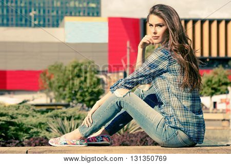 young urban woman in casual clothes  in the city