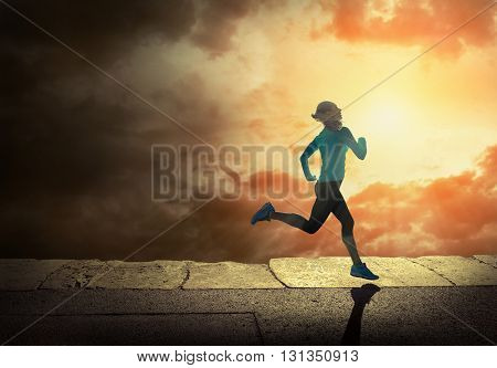 Woman running on the coastline under sunlight.