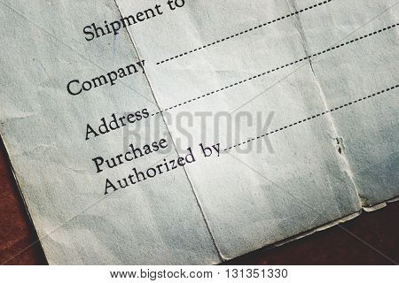 Vintage shipping invoice paper ephemera background with lens effect