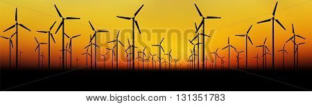 Silhouettes of wind turbines at the evening sky