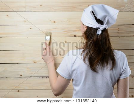 Woman Painter Standing At Wooden Wall