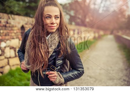 Happy and satisfied young woman enjoying life