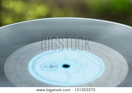 Old vinyl records close to the natural background