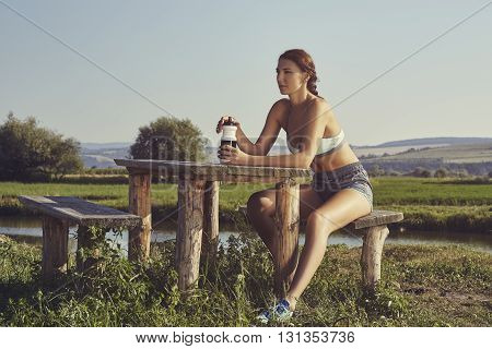 Woman Hydrating After Run