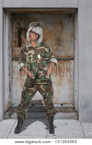 Beautiful young woman soldier in camouflage uniform
