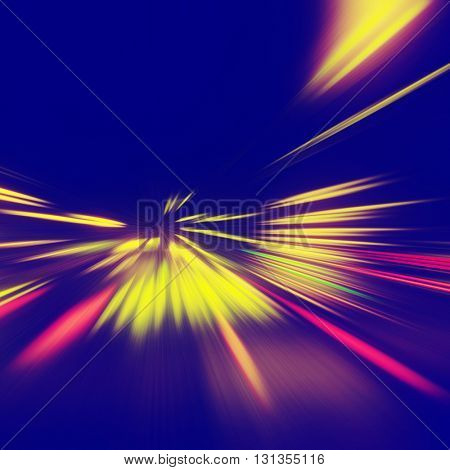 Abstract image of traffic lights on the road at night.