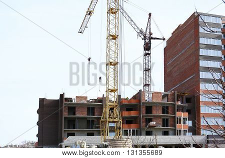 Engineering concept. Construction crane and building