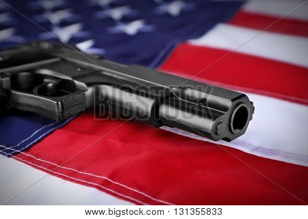 Gun on background of USA flag