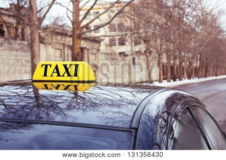 Taxi sign on car, outdoor