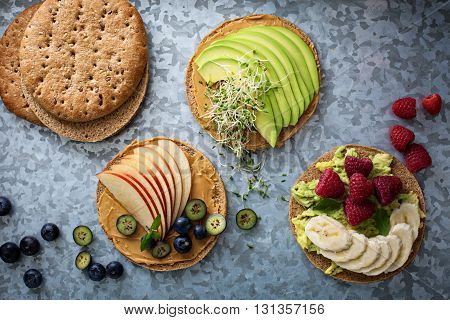 Wholegrain toast with variety of healthy toppings