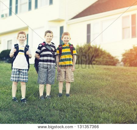 Three brothers outside their house going to school
