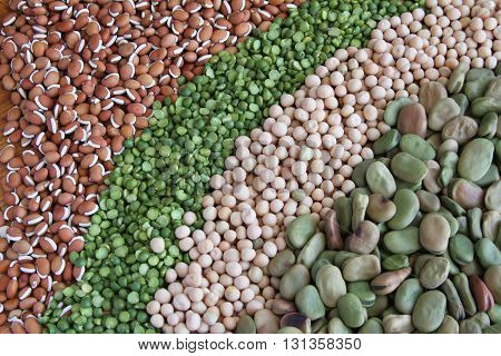 Colorful diagonal rows of dried peas and beans