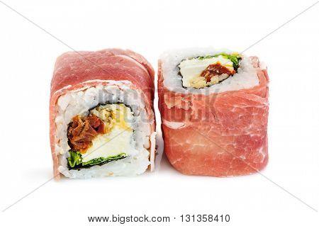 Uramaki maki sushi with procsiutto, two rolls isolated on white