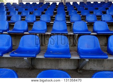 Plastic seating section on the the tribune of sport stadium