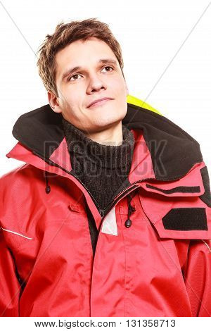 Young man in waterproof clothing. Portrait of firefighter.