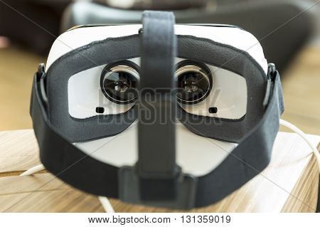 Sofia Bulgaria - May 13 2016: Virtual reality (VR) headsets (glasses) from behind. VR is immersive multimedia or computer-simulated reality - a computer technology that replicates an environment and simulates a user's physical presence and environment to