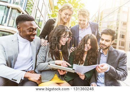 Business Group During Break Looking At Digital Tablet