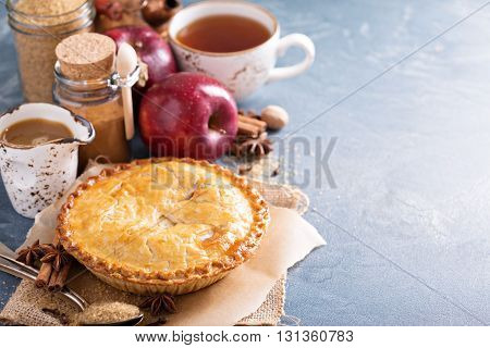 Apple pie with caramel syrup, spices and cinnamon