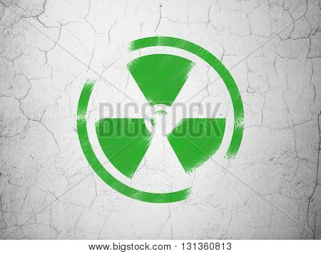 Science concept: Green Radiation on textured concrete wall background