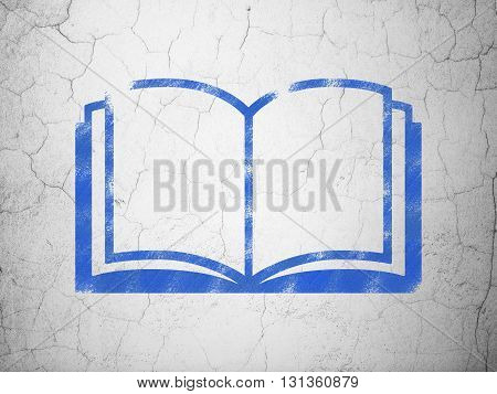 Science concept: Blue Book on textured concrete wall background