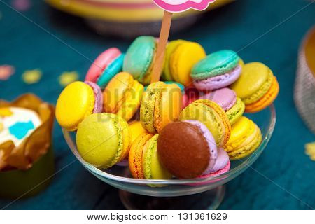 Colorful macaroons on the plate in candy bar