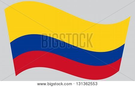 Flag of Colombia waving on gray background