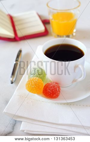 Morning coffee orange juice jelly sweets and ladies notebook