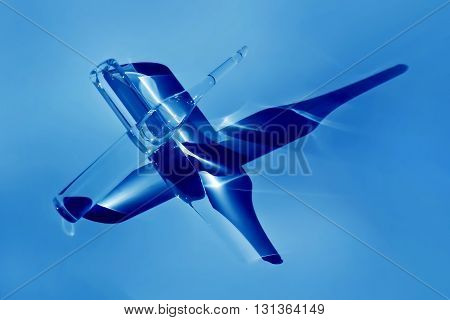 Two ampules in blue light with crossed deep shadows
