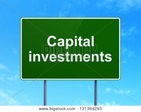 Currency concept: Capital Investments on green road highway sign, clear blue sky background, 3D rendering