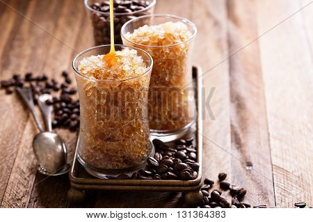 Coffee granita in small glasses with caramel syrup