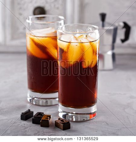 Iced coffee in tall glasses on the table