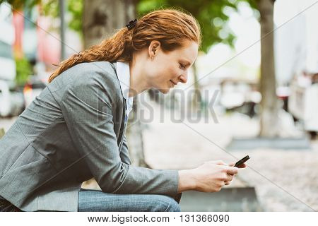 Businesswoman In A City With Mobile Phone