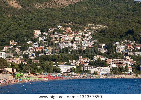 SUTOMORE MONTENEGRO - SEPTEMBER 08 2015: Unidentified people are relaxing on the beach. Montenegro is one of the most attractive destinations for tourists