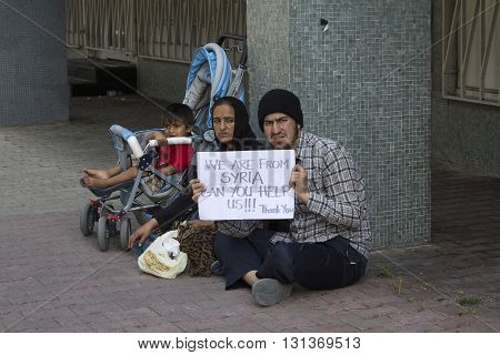 ISTANBUL TURKEY - AUGUST 03 2015 : Unknown refugees from Syria are asking for help on the street in Istanbul