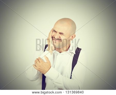 Bald Man Suffers From Toothache.