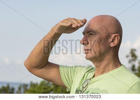 Seniors portrait contemplative old caucasian man. Close up
