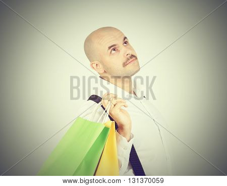 Caucasian Man Bald,  With Colorful Shopping Paper Bags