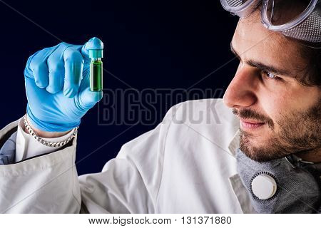 Gazing At A Green Vial
