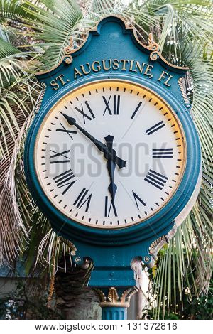 A pedestal street clock in historic St. Augustine Florida USA