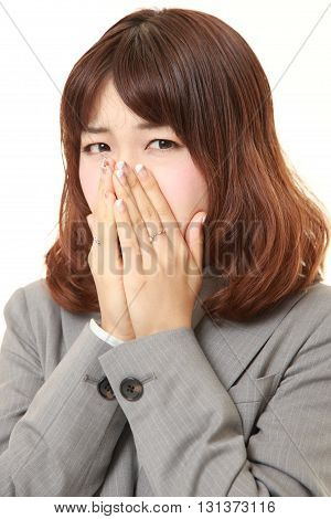 studio shot of frightened businesswoman on white background