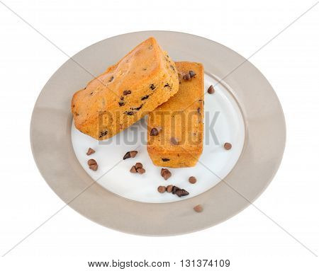 Chocochip muffin and chocolate granules on ceramic plate on isolated white background