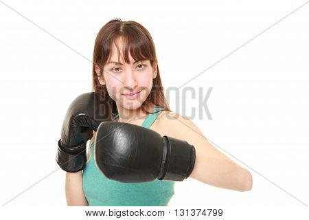 studio shot of female boxer throws a left hook